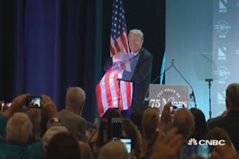Trump embraces American flag after NFIB speech