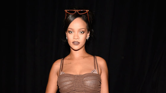 Rihanna Lets Her Hair Down After Savage X Fenty—And Gives a Lesson in Femme Fatale Beauty