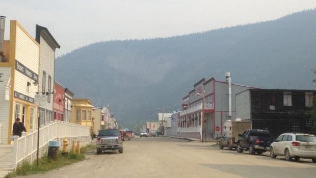 The Moosehide Slide in Dawson City, Yukon, is obscured Friday by smoke blowing in from wildfires in Alaska.