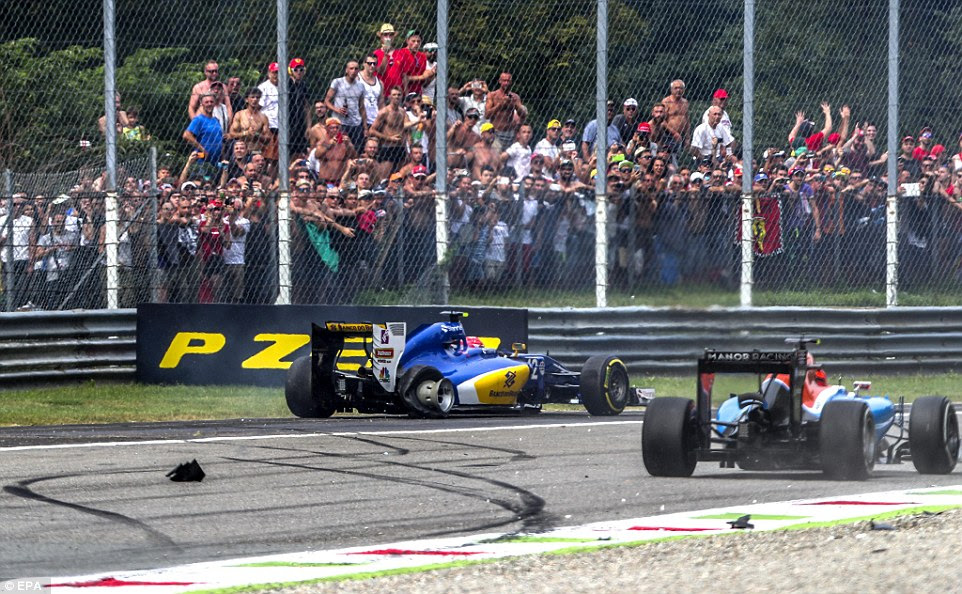 Nasr damages his right rear wheel after a collision with Palmer (not pictured) and both drivers were forced to retire