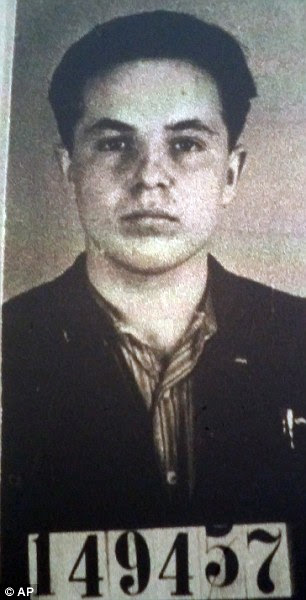This photo of Michael Karkoc was part of his application for German citizenship filed with the Nazi SS-run immigration office on Feb. 14, 1940