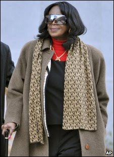 President Barack Obama's aunt, Zeituni Onyango, leaves the immigration hearing in Boston on 4 February 2010