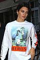 kendall jenner brightens up outfit with orange bag 03