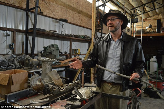 Dedicated: Spink, in his workshop in Washington State, has spent thousands of dollars to prove his theory