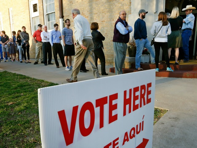 oters line up to cast their ballots on Super Tuesday March 1, 2016 in Fort Worth, Texas.