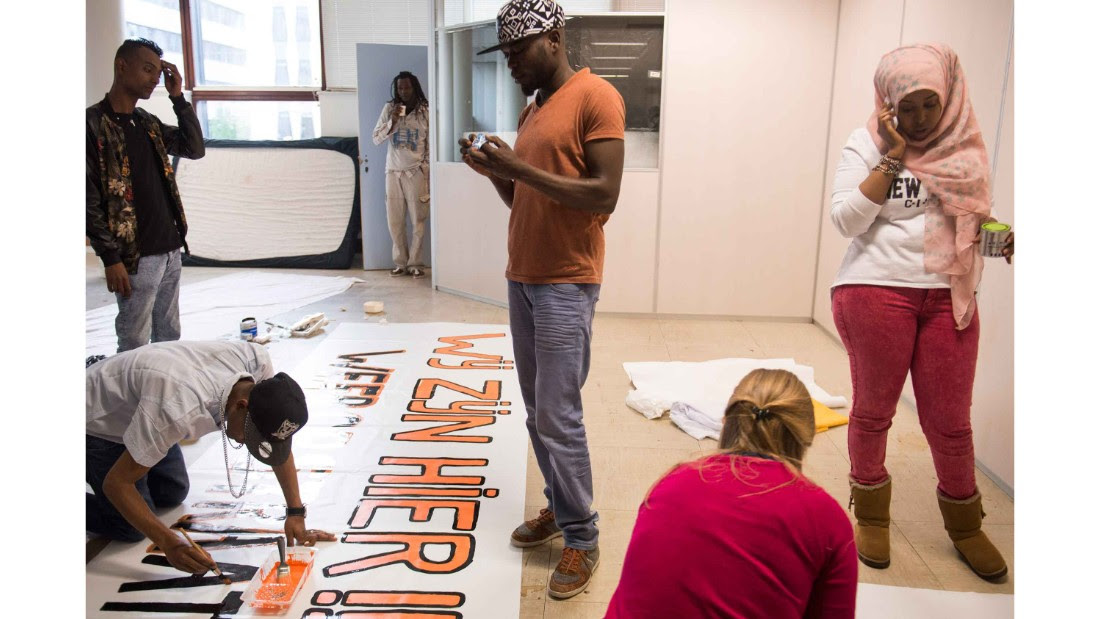 Group leaders and volunteers prepare signs for a demonstration on the eve an eviction in May 2015.