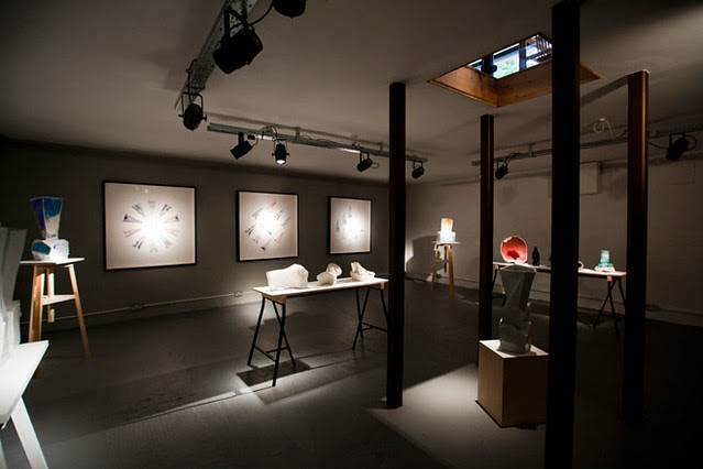 011 In the basement of the gallery, ceramics by Johannes Nagel are shown alongside Studio Glithero's Paper Planes project - a collaboration with the Baddeley Brothers.