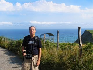 Mike on the path with the ocean in the background