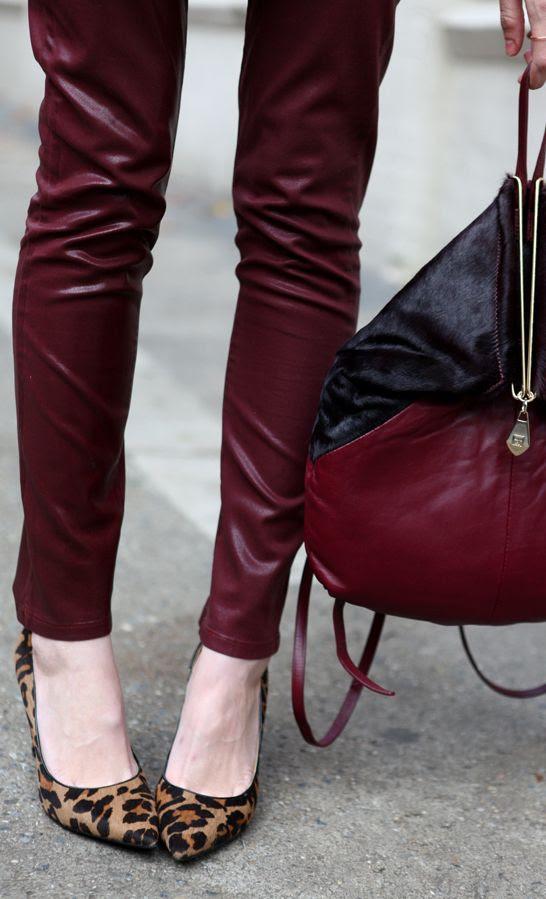 Burgundy shiny skinnies, black heels, burgundy and black bag...LOVE Burgundy with black and gold!