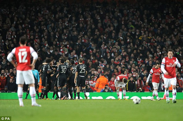 Down and nearly out: Arsenal players reflect on another bad night as Bayern celebrate their victory in north London