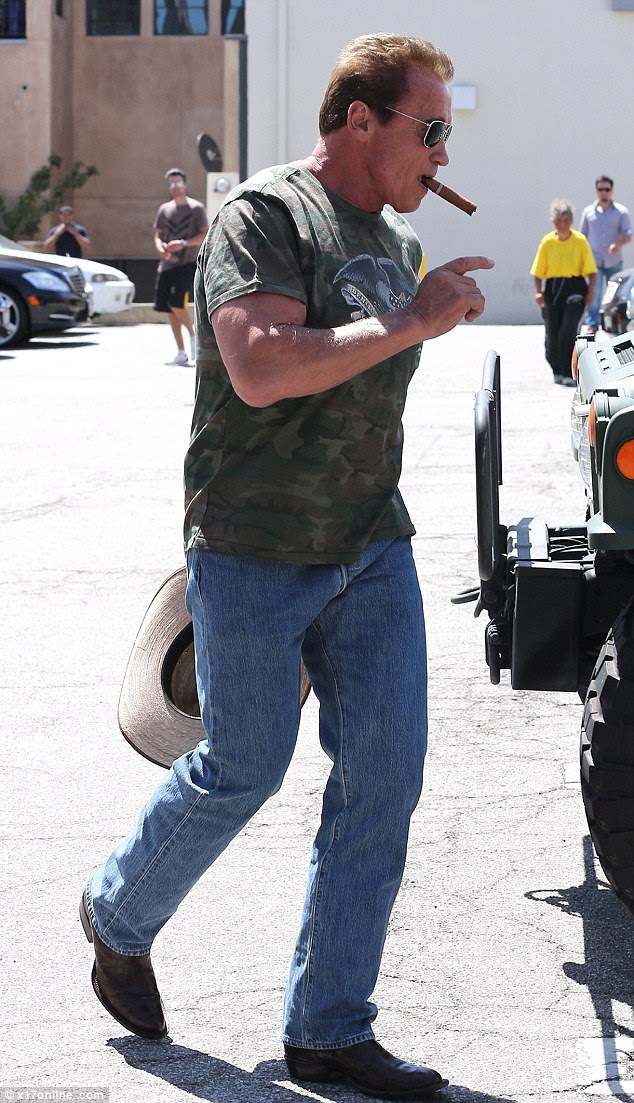 Born in the USA?: Arnold Schwarzenegger looked like a true-blue American as he stepped out for lunch at Cafe Roma in Beverly Hills on Saturday with a cowboy hat and cowboy boots on