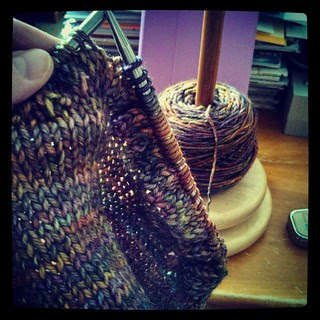 Picked up these 600 stitches again..need to finish #justenoughruffles #scarf #malabrigo Using my #YarnCaddy from #theloopyewe for the first time! #knitstagram