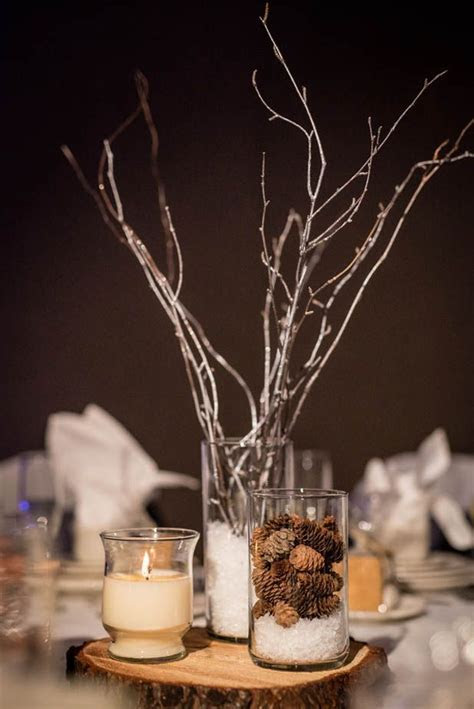 Faux snow winter wedding centerpieces with log slices