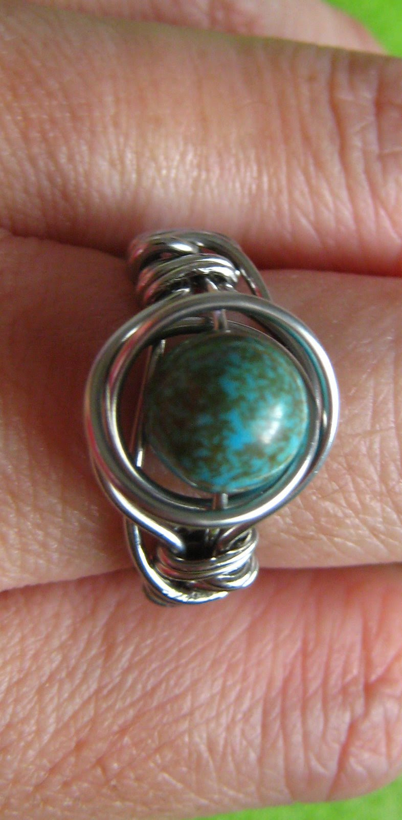 twice around the world (TAW) wire wrap ring on finger