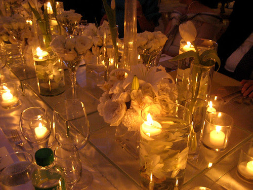 White roses, wine glasses and candles