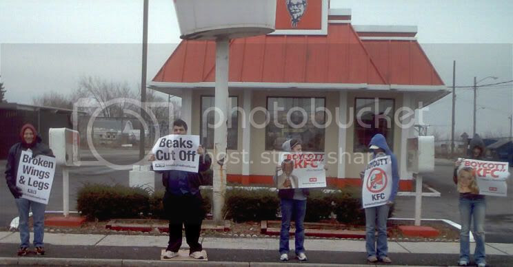 KFC Protestors with signs