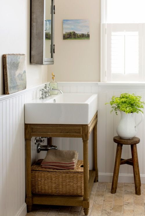 Simple, neutral bathroom with large farmhouse sink | Friday Favorites at www.andersonangrant.com