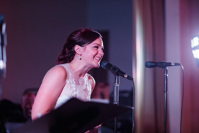 Bride sings at a wedding Reception at the Verdi Club by Mindy Joy Photography