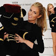 That's one way to ensure high bids! Abbey Crouch shows off her amazing long legs in black body as she takes to the stage at Children in Need Pudsey bear auction