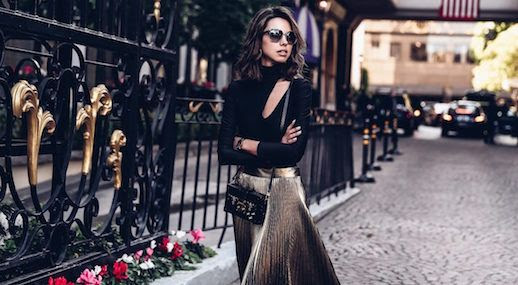 Le Fashion Blog Black Body Suit With Cut Out Valentines Day Outfit Gold Pleated Skirt Black Pumps Via Viva Luxury