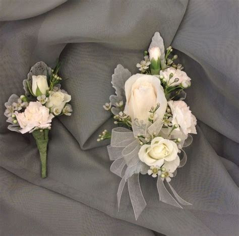 Soft pink and white mother and father of the bride corsage