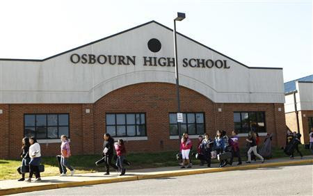 Students pass in front of Osbourn High School in Manassas, Virginia, April 25, 2012.REUTERS-Kevin Lamarque