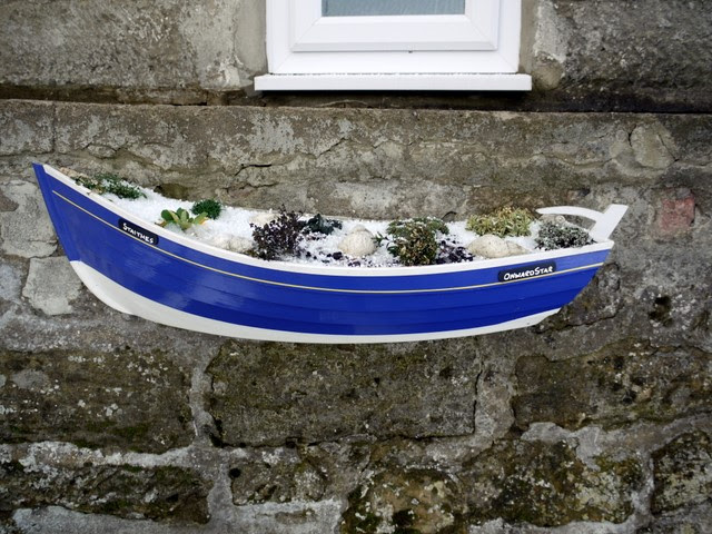 :Coble fishing boat planter, Boulby - geograph.org.uk - 1626138.jpg