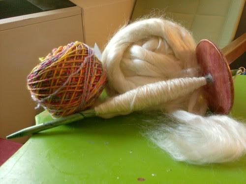 Handspun tussah peace silk on a drop spindle and handspun rainbow silk yarn