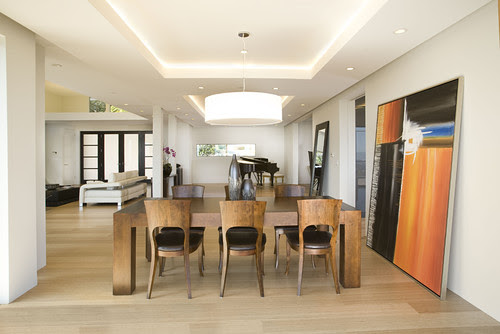 large leaning abstract art dining room