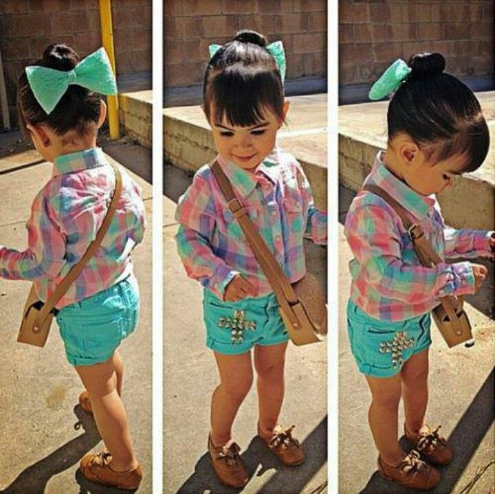 plaid long sleeve shirt with turquoise studded cross shorts and matching color bow brown shoes to fulfill the outfit