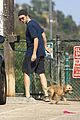 robert pattinson gets in some exercise at the dog park 05