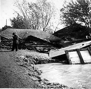 Another view of the debris of broken houses, s...