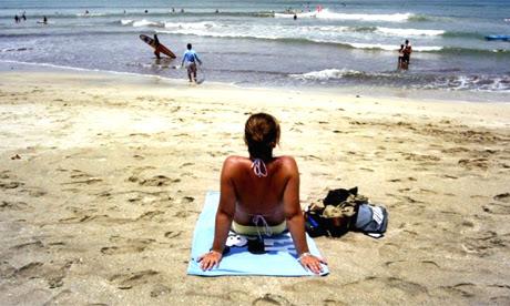 Traveller on a beach, Indonesia