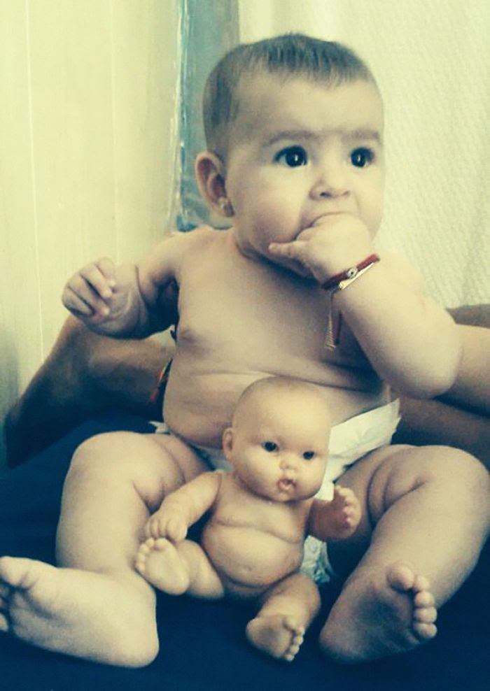 Baby With A Look Alike Doll