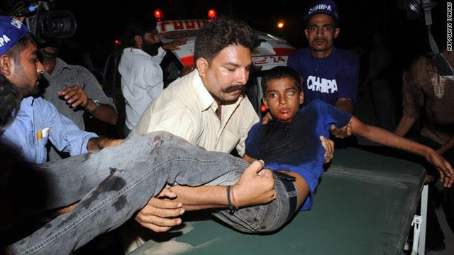 Pakistani volunteers shift an injured blast victim to a hospital in Karachi.