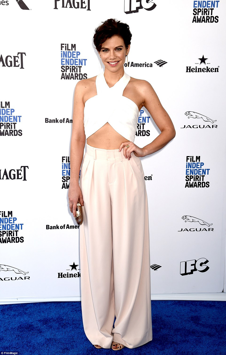 So Seventies: Actress Lauren Cohan stood out in a white halter top and beige wide legged slacks