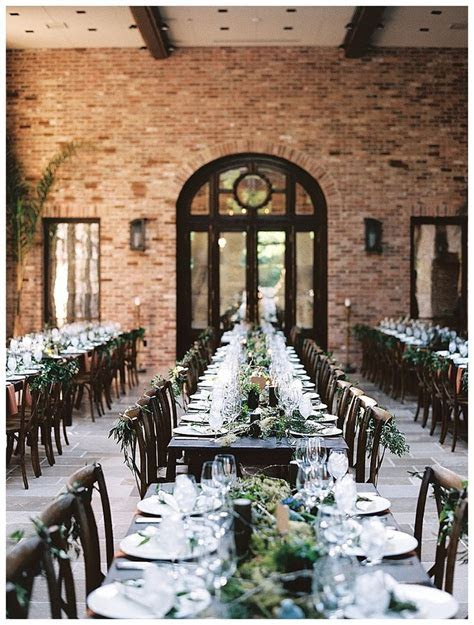 Wedding reception with long rows of dark wood tables set