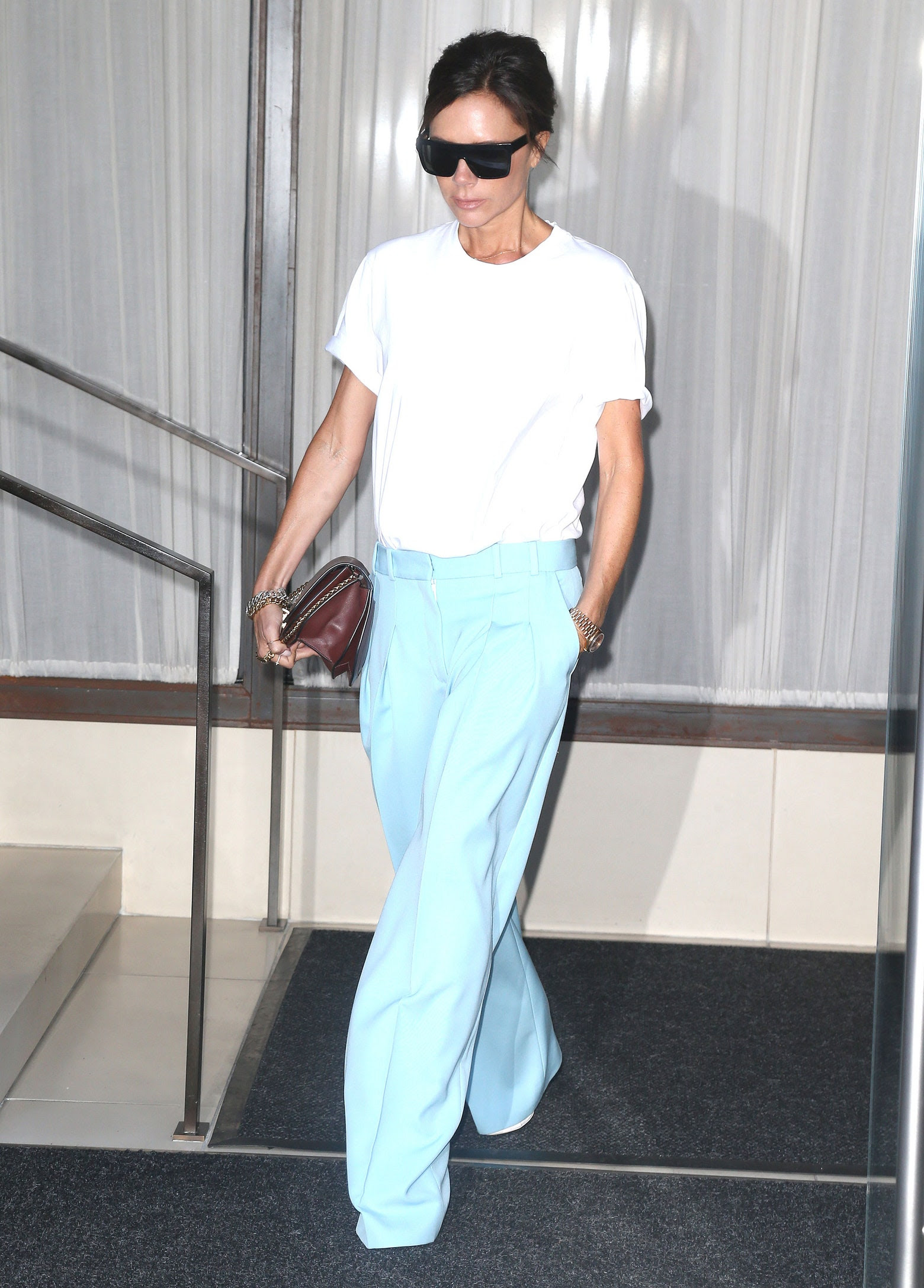 Le Fashion Blog Victoria Beckham Oversized Sunglasses White T Shirt Wide Leg Blue Pants Via Vogue
