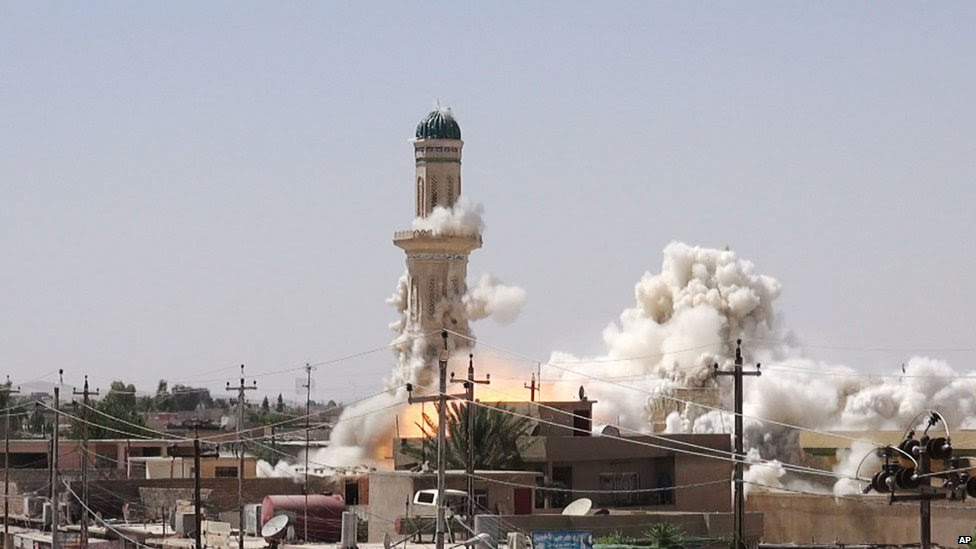 Al-Qubba Husseiniya, a Shia shrine, being blown up in the city of Mosul.