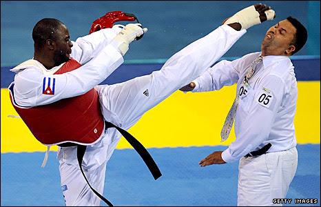 Angel Valodia Matos attacks the referee