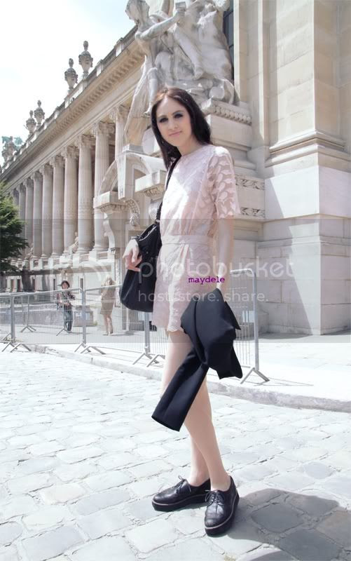 Lida Fox outside Chanel Haute Couture wearing pink playsuit and creepers