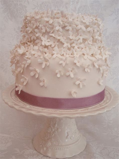 White floral engagement cake with pink ribbon.PNG (1