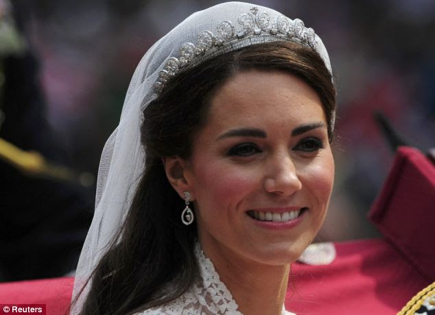 The smiling bride: An unveiled Kate Middleton. An estimated two billion people tuned in for her wedding