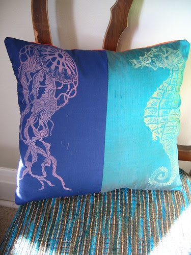 jellyfish and seahorse pillow on chair