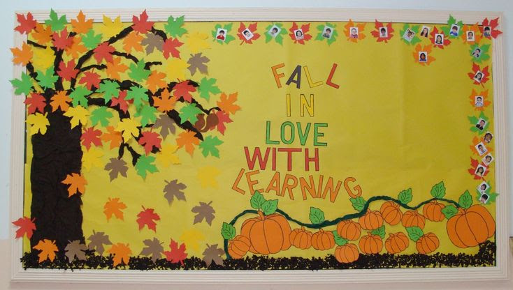 """Fall In Love With ______"" is a popular title for an autumn bulletin board display.  This teacher has added student photos inside the leaves (along the top and right) and her tree and pumpkin patch are very eye-catching."
