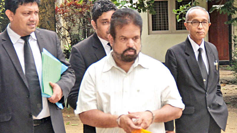 Shalila Moonasinghe with his lawyers. Picture by Shan Rambukwella