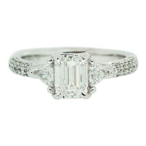 Diamond Engagement Ring With Triangle Diamond Side Detail