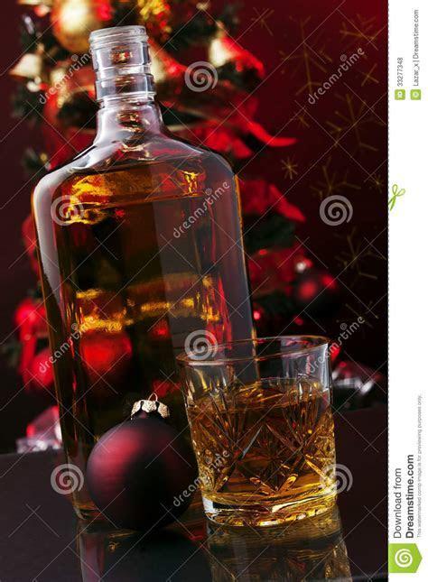 Whiskey and Christmas tree stock photo. Image of festive