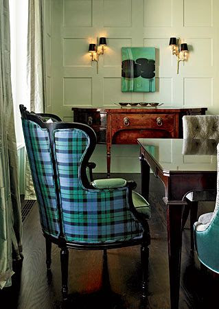 Love at first sight -- A wingback chair, with black lacquered frame, covered in silk tartan.