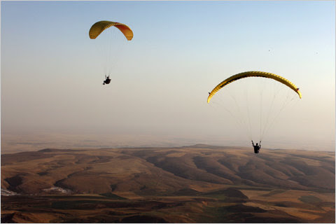 Members of the Falcon Aviation Club paragliding near Mosul.